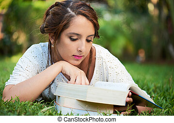 girl laying while reading