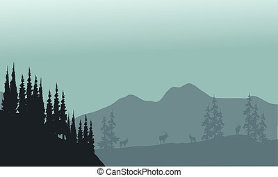 Landscape hills with spruce and antelope silhouette a...