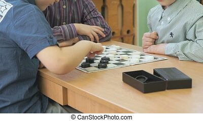 Children play checkers games at a kindergarten - Children...