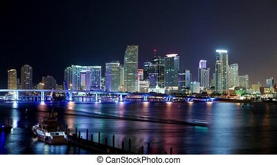 Time lapse shot of the colorful Miami Skyline at night -...