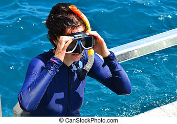 Woman prepare to snorkeling dive