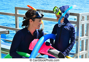 Mother and daughter prepare to snorkeling dive