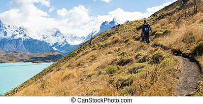 family hiking in patagonia - panorama of young father and...