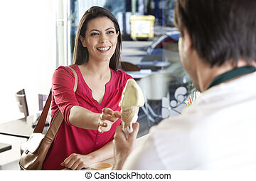 Mid Adult Woman Receiving Ice Cream From Waiter - Smiling...