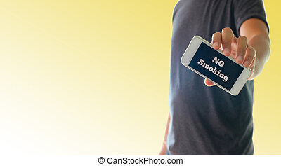 a man using hand holding the smartphone with text No smoking...