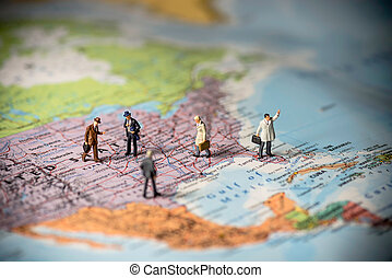 Miniature business people on top of US map Business concept...