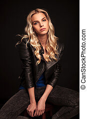 fashion blonde woman in leather jacket posing