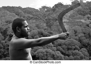 Yirrganydji Aboriginal warrior throw boomerang during...