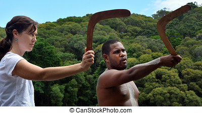 Yirrganydji Aboriginal warrior teaches a young woman how to...