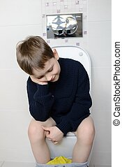 6 year old boy sitting on the toilet - Thoughtful 6 year old...