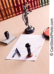 The document waiting for the signature of a notary.