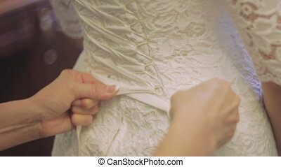Lacing Wedding Dress. Closeup - Lace Bride in Wedding Dress....