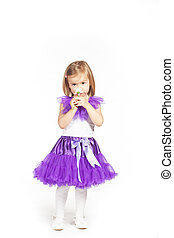 Little girl in a purple skirt
