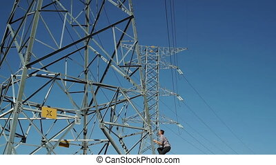 Male Climbs Electrical Tower - Man climbs high tension...