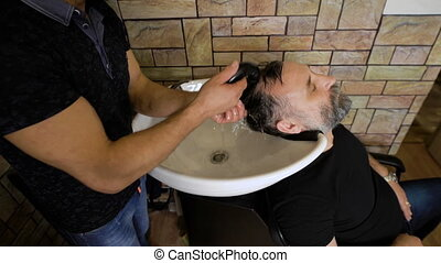 eccentric stylist washes head respectable men Businessman...