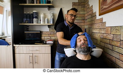 eccentric stylist washes head respectable men. Businessman visits to his barber, that would shear the beard.