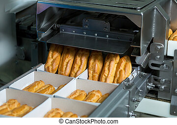 Boxes with pastry on conveyor.