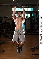Young Man Doing Exercise For Back - Young Muscular Fitness...