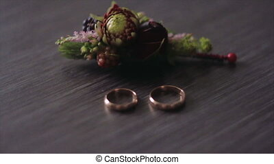 Rings And Flowers Grooms Boutonniere Closeup - Two Gold...
