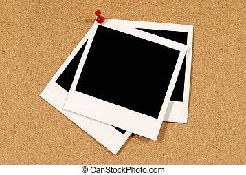 Polaroid prints on cork