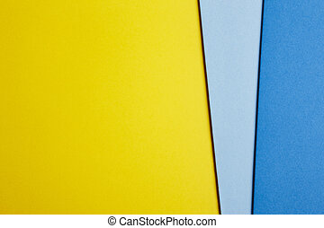 Colored cardboards background in yellow blue tone Copy space...