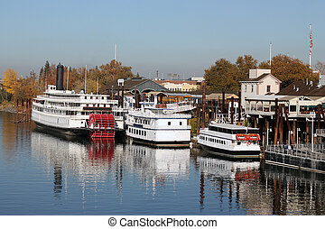 Old Sacramento - Boats on American River in Old Sacramento,...