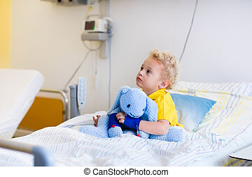 Little boy in hospital room - Little boy playing with his...