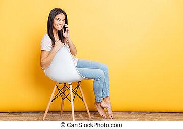 Woman talking on the phone - Happy beautiful woman sitting...