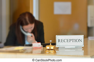 hotel reception desk with bell