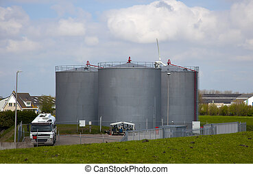 Oil tanks at industrial site with nice blue sky