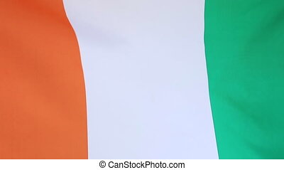 Closeup flag of Ivory Coast - Closeup of textile flag of...