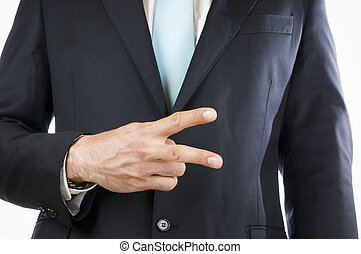 finger two - Ventral view of a young man in a black suit...