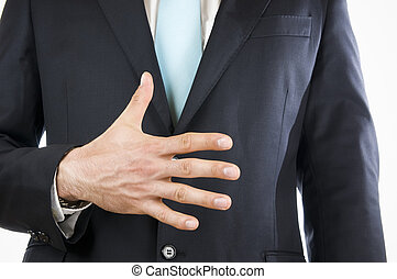 finger five - Ventral view of a young man in a black suit...