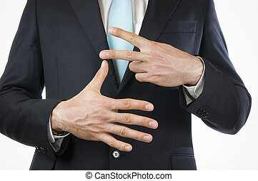finger seven - Ventral view of a young man in a black suit...
