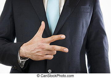 finger three - Ventral view of a young man in a black suit...