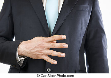 finger four - Ventral view of a young man in a black suit...