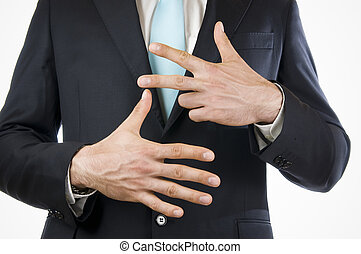 finger eight - Ventral view of a young man in a black suit...