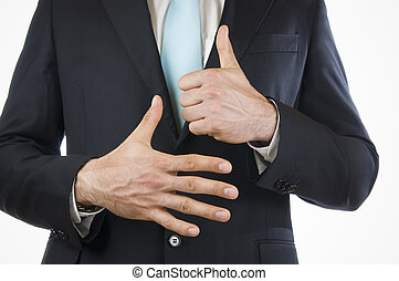 finger six - Ventral view of a young man in a black suit...