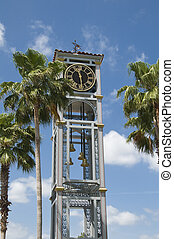 Clock Tower - Metal structure clock tower with partly cloudy...