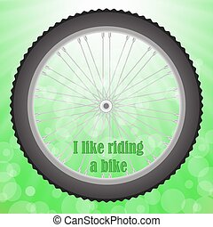 Bicycle Wheel Isolated on Summer Green Blurred Background