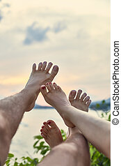 Couple's feet having fun. vacation concept
