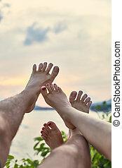 Couple's feet having fun. vacation concept