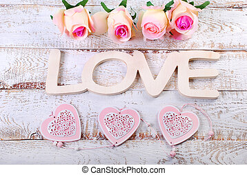 romantic love background with word love,hearts and roses on...