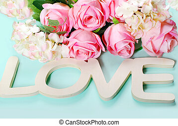 romantic love background in pastel colors with wooden word...