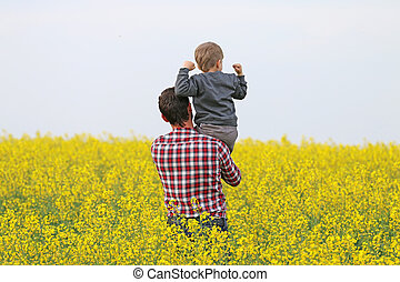 a man with a boy in a field