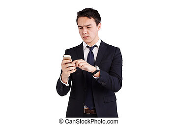 Young Caucasian business man frowning looking at mobile...