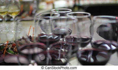 row of elegant red wine glasses on the bar - close up shot...