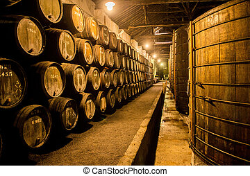 Barrels in the wine cellar, Porto, Portugal - Old Barrels in...