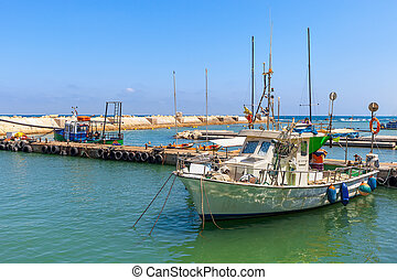 Fishing boat in Jaffa. - Small fishing boat in port of...