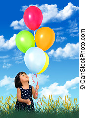 Asian Little Chinese Girl Holding colorful balloons
